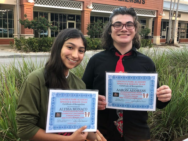 Alyssa Monaco and Aaron Address receive certificates commemorating their tournament participation as the first LPA students to compete in Public Speaking in many years.