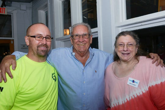 Event Accountants Paul Jakubczak, left, Jay Taylor and Ann Corbin at Family Meals' fourth annual Celebrity Bartender's Event at Cobb's Landing in Fort Pierce.
