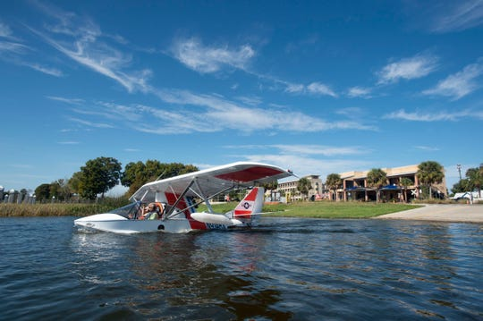 "A seaplane glides into Lake Dora on Thursday, Nov. 8, 2018 in Tavares. Since the city invested millions into the seaplane industry and embraced the title of ""America's Seaplane City"" about 10 years ago, the city of about 17,000 residents has ""boomed"" and now offers multiple entertainment-friendly options, including several new restaurants, hotels, weekend-long events and a wedding pavilion on the lake, according to city administrator John Drury."