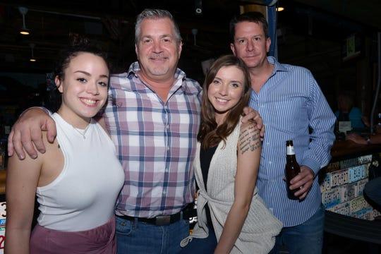 Eleanor Billman, left, David Reid, Morgan Nucci and Robert Rydzewski at Family Meals' fourth annual Celebrity Bartender's Event at Cobb's Landing in Fort Pierce.