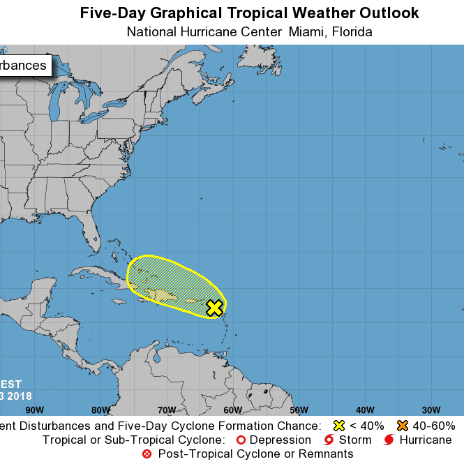 Tropical wave becoming less organized; chances for development drop as it interacts with land