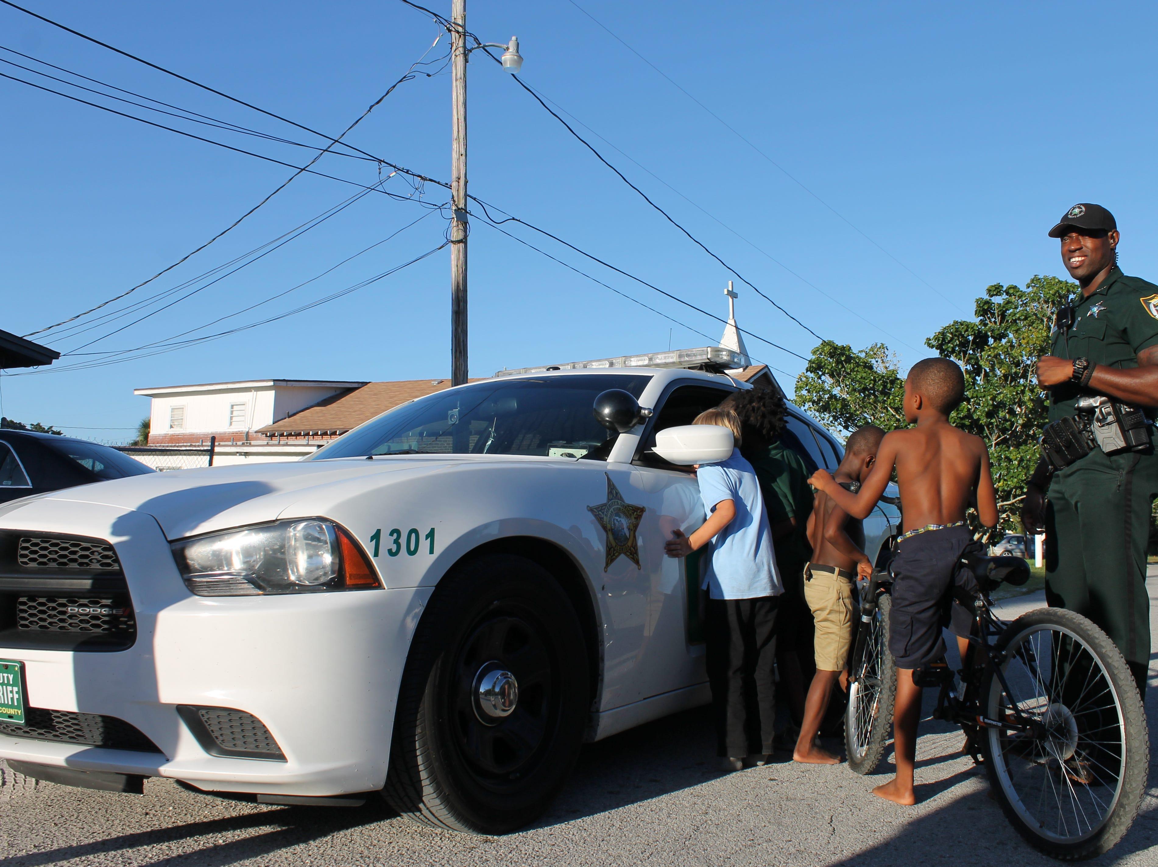 Dwayne Hoilett with some neighborhood children.