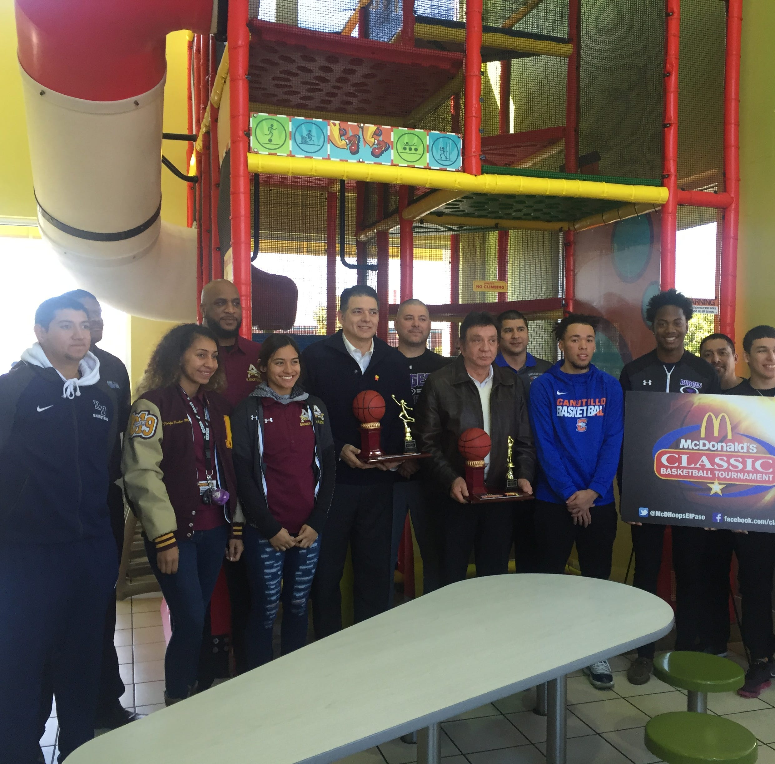 Teams gather together for Tuesday's announcement of this year's McDonald's Classic Basketball Tournament, Dec. 6-8.