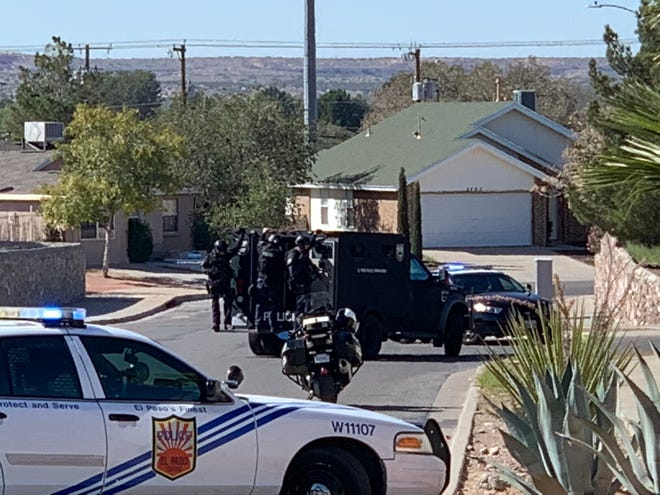 An El Paso Police Department SWAT team stands ready Tuesday morning on the 5400 block of Thorn Ridge Circle.