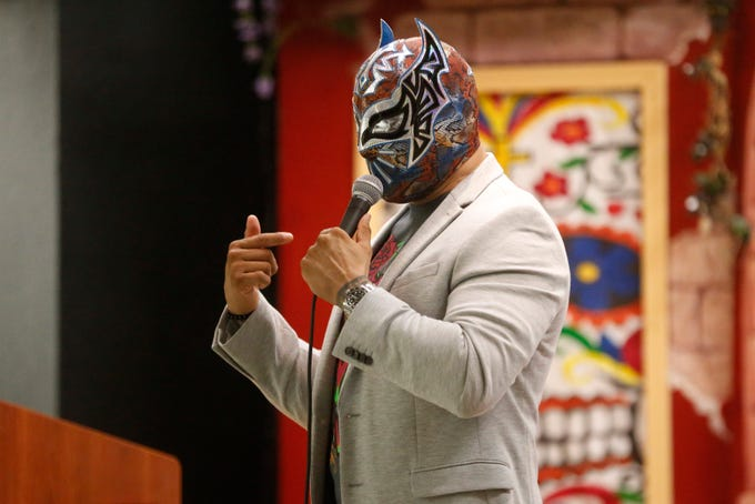 "FirstLight Federal Credit Union Sun Bowl Parade Grand Marshal, WWE Superstar Sin Cara made a private appearance for about 200 students at the La Fe Community Center on Tuesday afternoon. Sin Cara spoke to the students about growing up in south El Paso and setting his mind to meet his goals of becoming a professional wrestler. ""Staying in school, being respectful, and working hard for what you want you can accomplish anything,"" Sin Cara told the students. After addressing the students Sin Cara gave each student an autographed photo of himself."