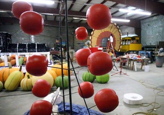 Fruit made of styrofoam are being shaped and painted. They will be part of a cornucopia on the FirstLight Federal Credit Union lead parade float.