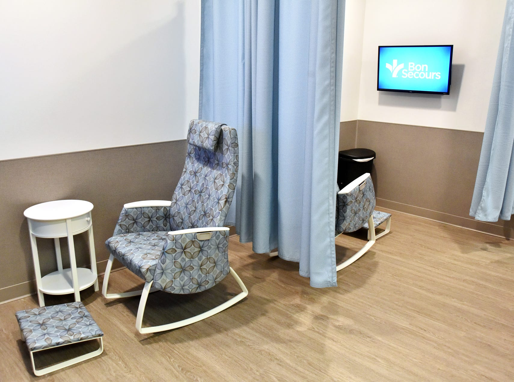 Private nursing areas with rocking chairs and curtains are part of the  mothers nursing suite at the Bon Secours Wellness arena.