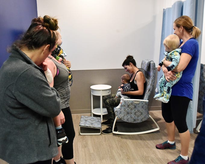 Members of the Strong Mamas fitness group tour the mothers nursing suite at Bon Secours Wellness Arena after a blessing ceremony Tuesday morning, November 13, 2018.