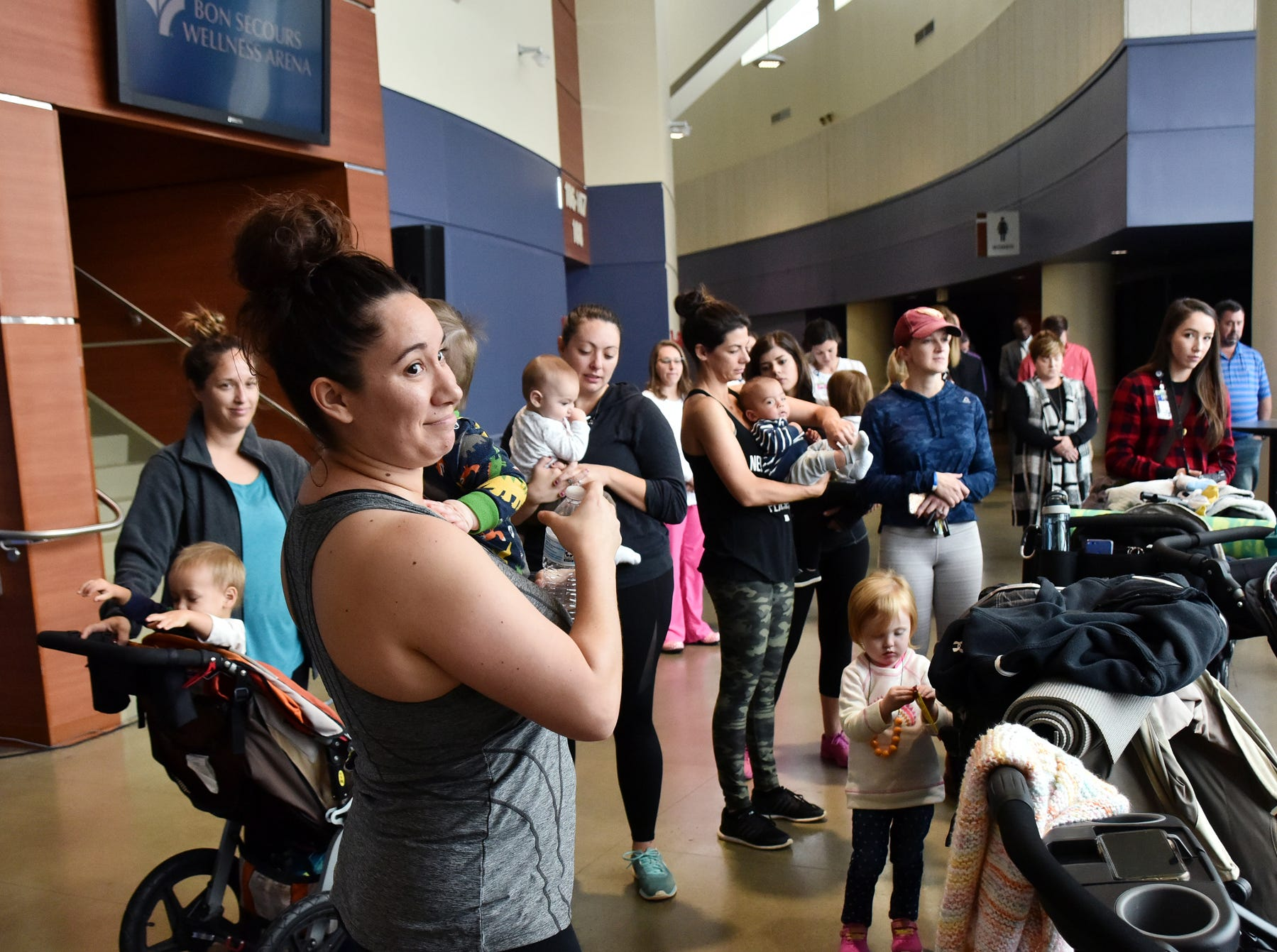 Members of the Strong Mamas fitness group attend a blessing ceremony for the  mothers nursing suite at the Bon Secours Wellness arena Tuesday morning, November 13, 2018.