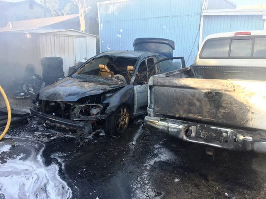 Two vehicles burned in a structure fire Monday night on Harrison Avenue in Ventura, city fire officials said.