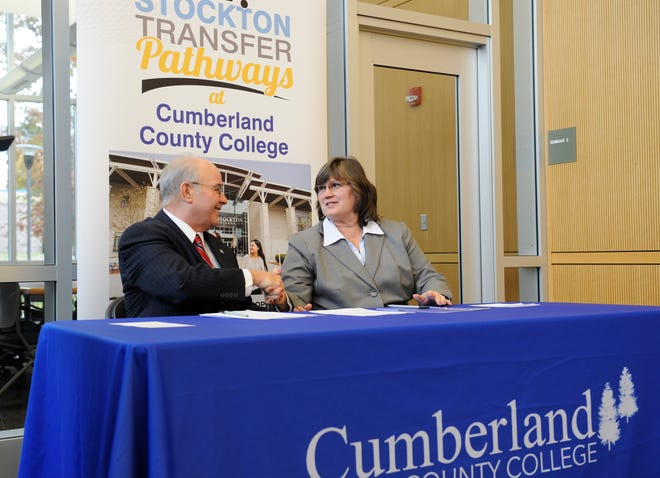 Harvey Kesselman, Ed.D., Stockton University President and Shelly O. Schneider, Ed.D., Cumberland County College Interim President shake hands after signing a dual admission and transfer agreement at Cumberland County College on Tuesday, November 13, 2018.