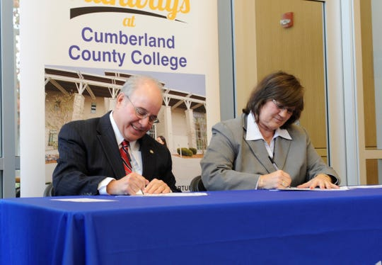 Harvey Kesselman, Ed.D., Stockton University President and Shelly O. Schneider, Ed.D., Cumberland County College Interim President sign a dual admission and transfer agreement at Cumberland County College on Tuesday, November 13, 2018.