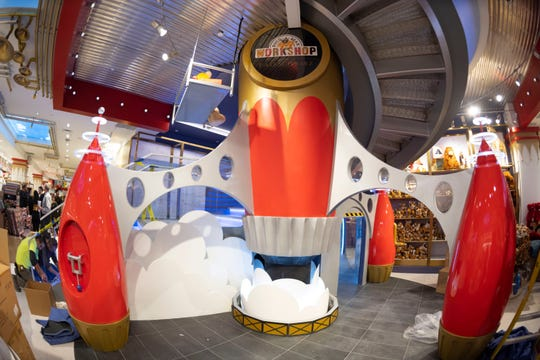 FAO Schwarz returns to New York after a three-year absence. Among the new offerings is a two-story rocket ship that rumbles regularly and has nooks for little ones to play in.