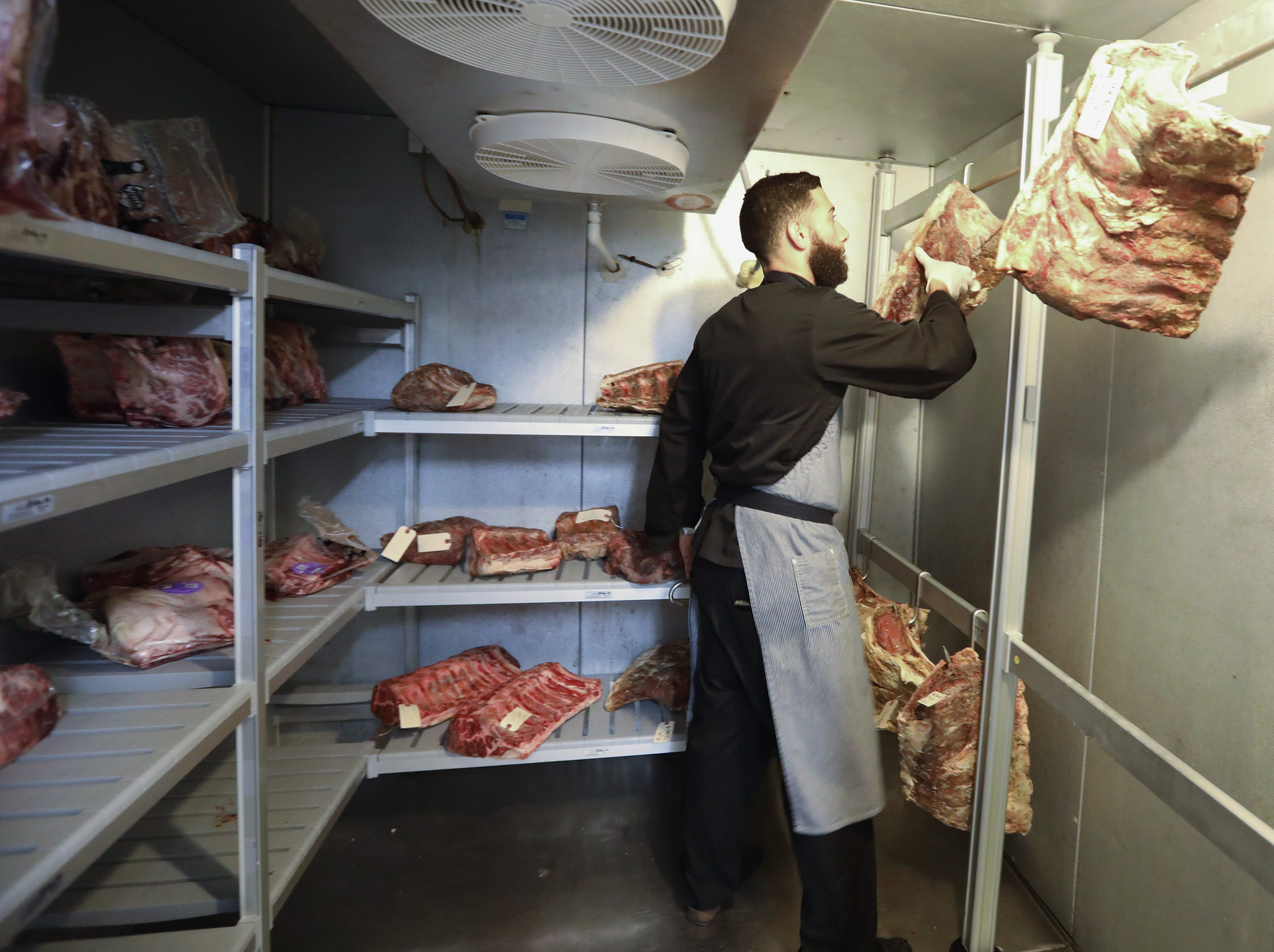 Chef Gustavo Gutierrez in the dry aging room at the Ridge Steakhouse in Airmont Nov. 13, 2018.