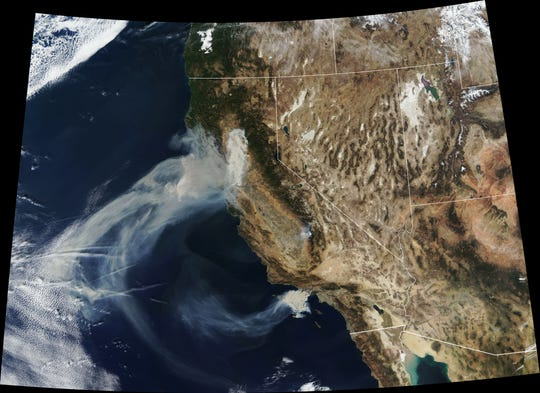 Image of the Camp Fire in Northern California and the Hill and Woolsey fires in southern California, taken Nov. 9, 2018, by the Moderate Resolution Imaging Spectrometer on NASA's Terra satellite.