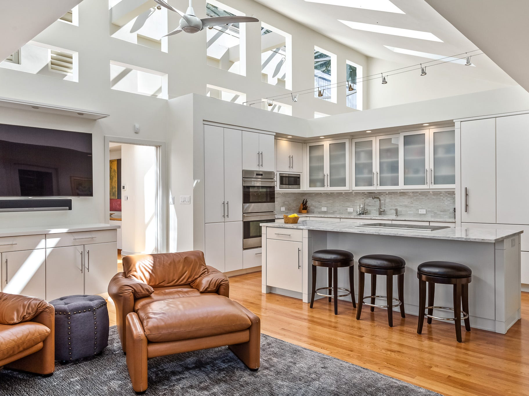 A recently renovated kitchen at 3611 Centerville Road in Greenville opens to a spacious family room.