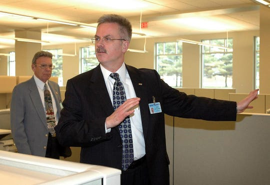 Then-Director of Planning Services Michael Petit de Mange explains how new office space will be used during a 2005 tour of the new Kent County administration building in Dover. Petit de Mange was named County Administrator in 2007.