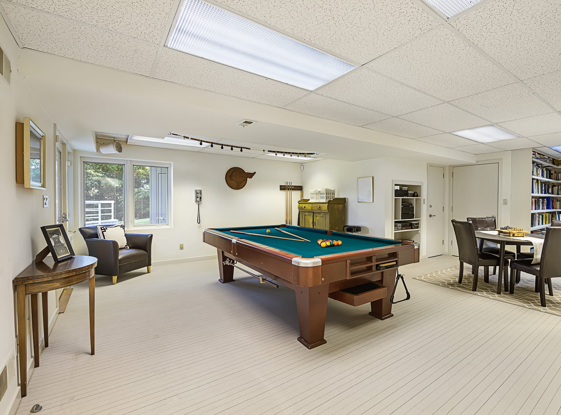 The lower level of 3611 Centerville Road in Greenville includes a game room and library.