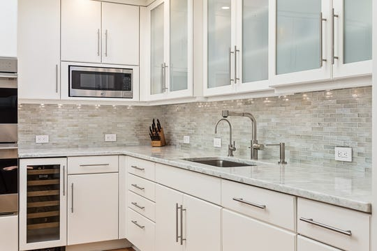 The kitchen 3611 Centerville Road in Greenville has marble counter tops and a glass back splash.