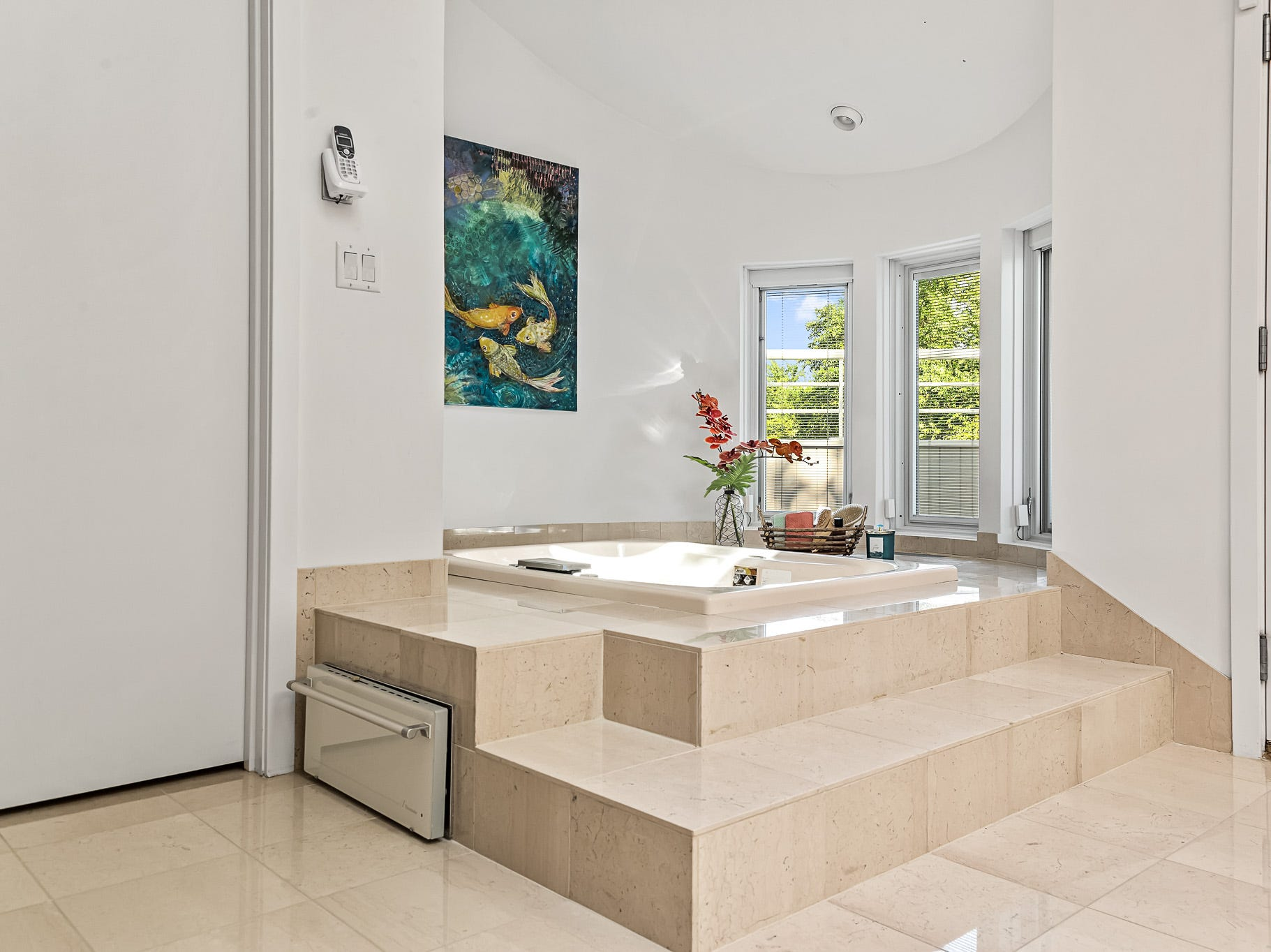 The master bath at 3611 Centerville Road in Greenville includes an elevated jetted tub.