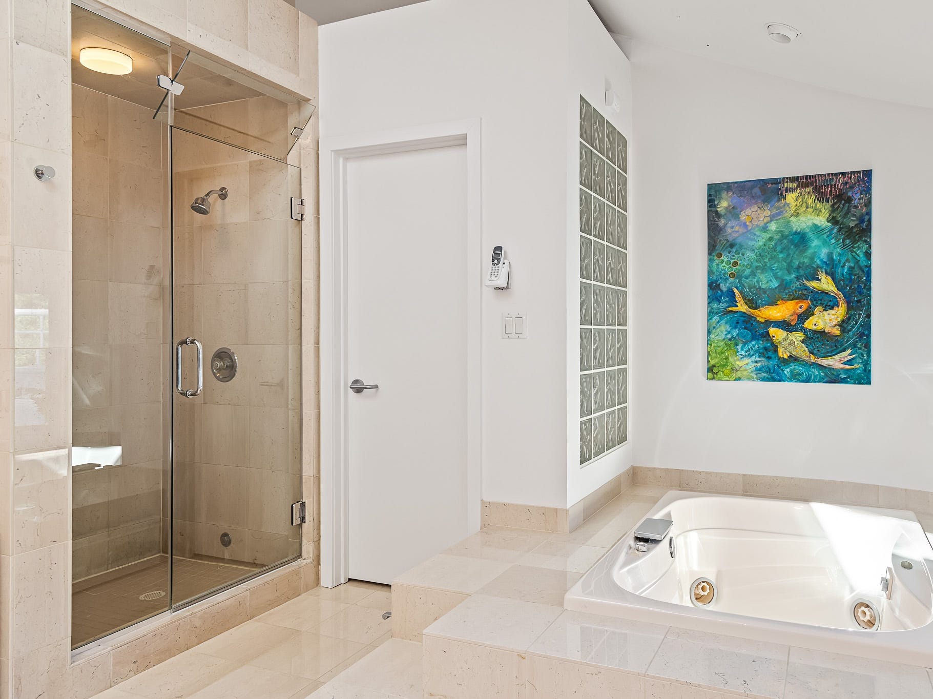 The large master bath at 3611 Centerville Road in Greenville features a jetted tub and a steam shower.