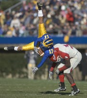 Delaware receiver Aaron Love (17) is upended by Delaware State defensive back Ryan Robinson after a 14-yard catch on Delaware's second touchdown drive in the first quarter in the Blue Hens' 44-7 win over the Hornets in the first round of the NCAA Div. I-AA playoffs Friday, November 23, 2007 at Delaware Stadium.