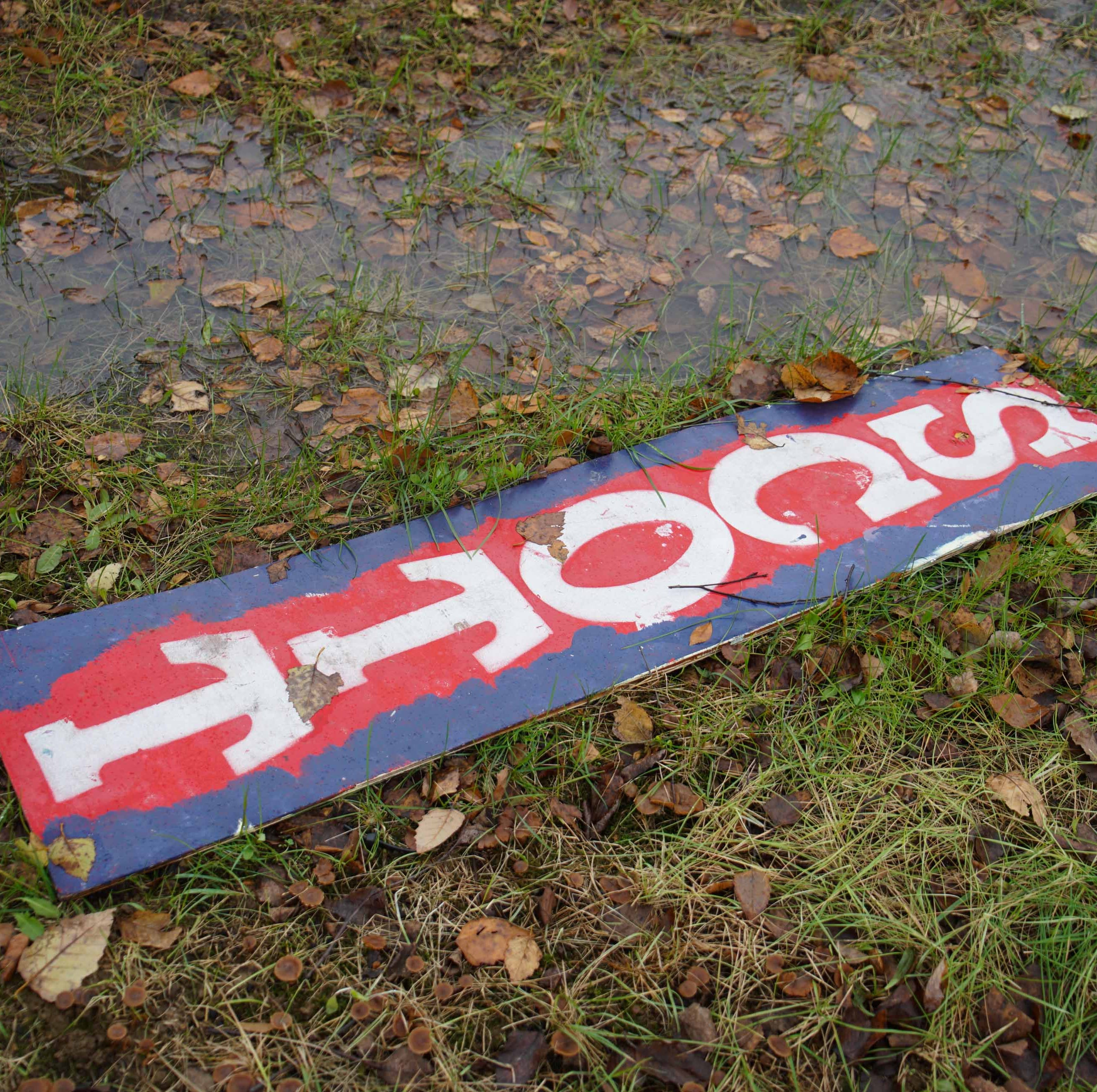 Remnants of a Scott Walker campaign sign from the midterm election sit near a puddle of water at Augustine Cut-Off and U.S. 202.