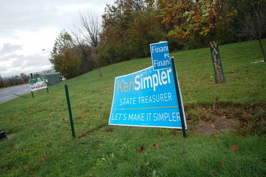 Midterm election campaign signs are seen at Augustine Cut-Off and U.S. 202.