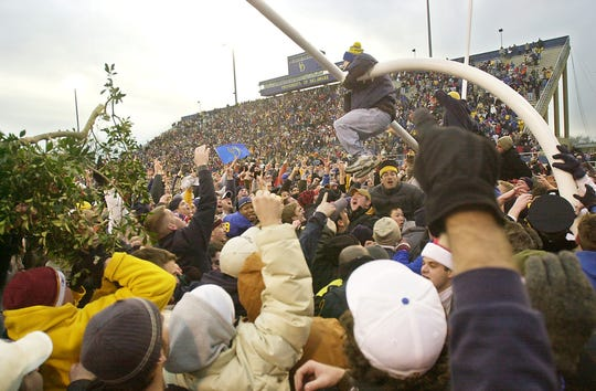 Fans try to bring down the north end zone goalpost after Delaware defeated Wofford 24-9 in the I-AA semifinals at Delaware Stadium, Saturday Dec.13, 2003.