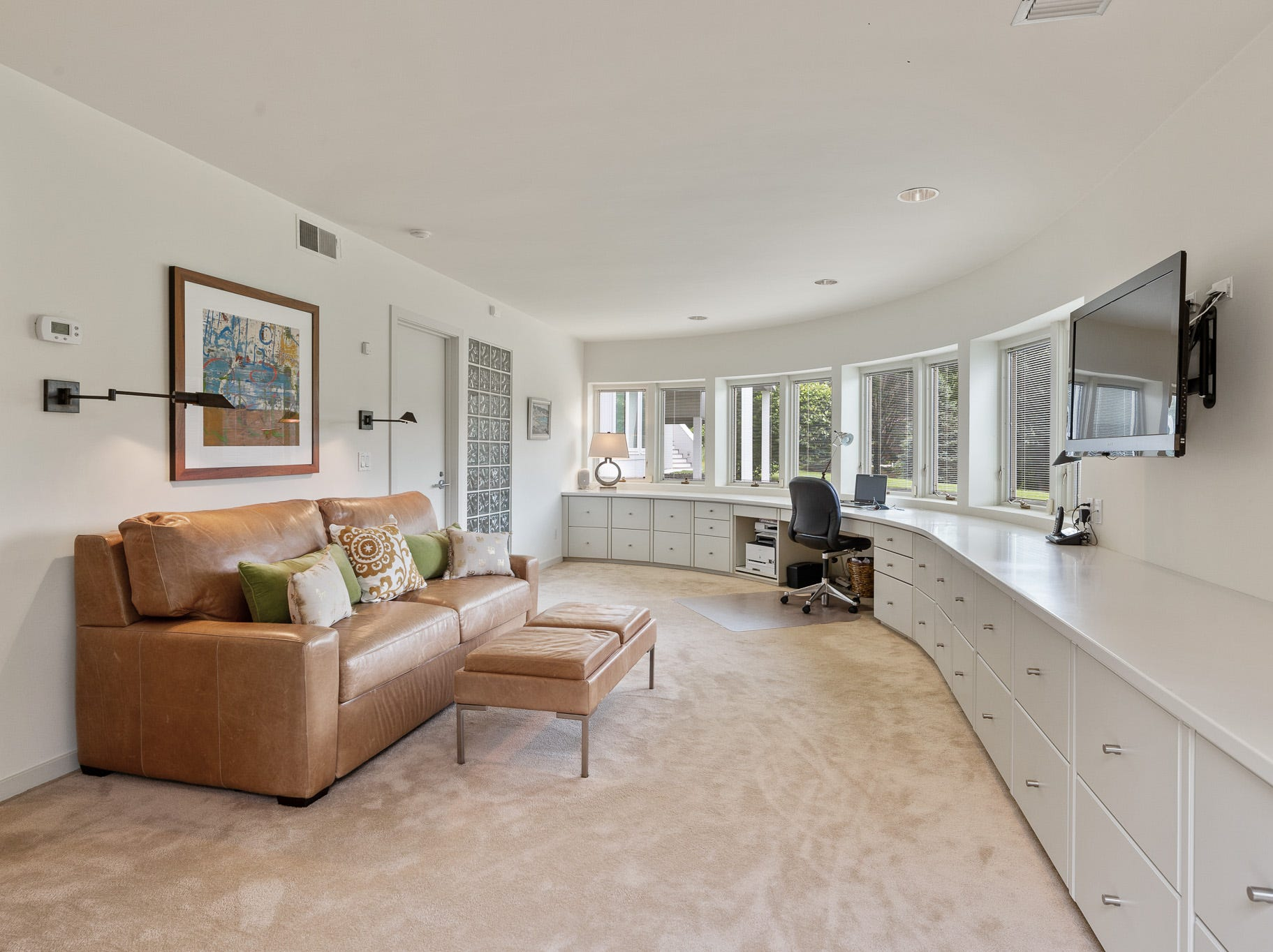 The lower level of 3611 Centerville Road in Greenville features lots of space for entertaining.