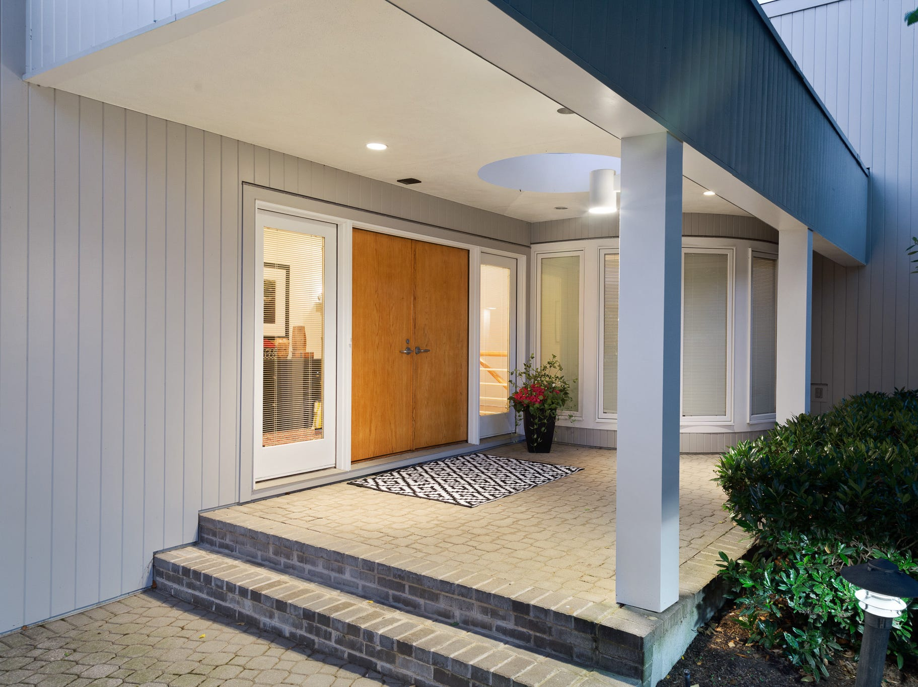 Night lights add drama to the entrance of the contemporary house at 3611 Centerville Road in Greenville.