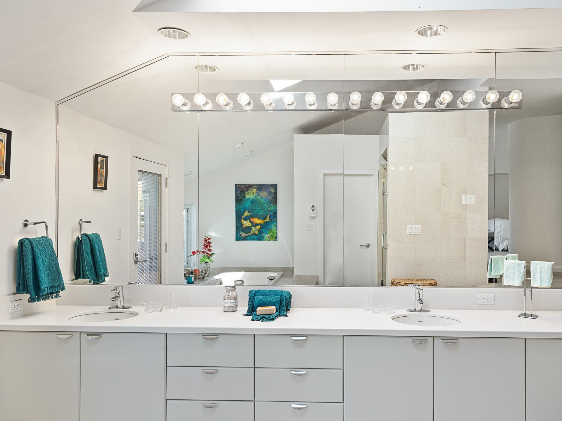 The master bath at 3611 Centerville Road in Greenville features a skylight, jetted tub and steam shower.