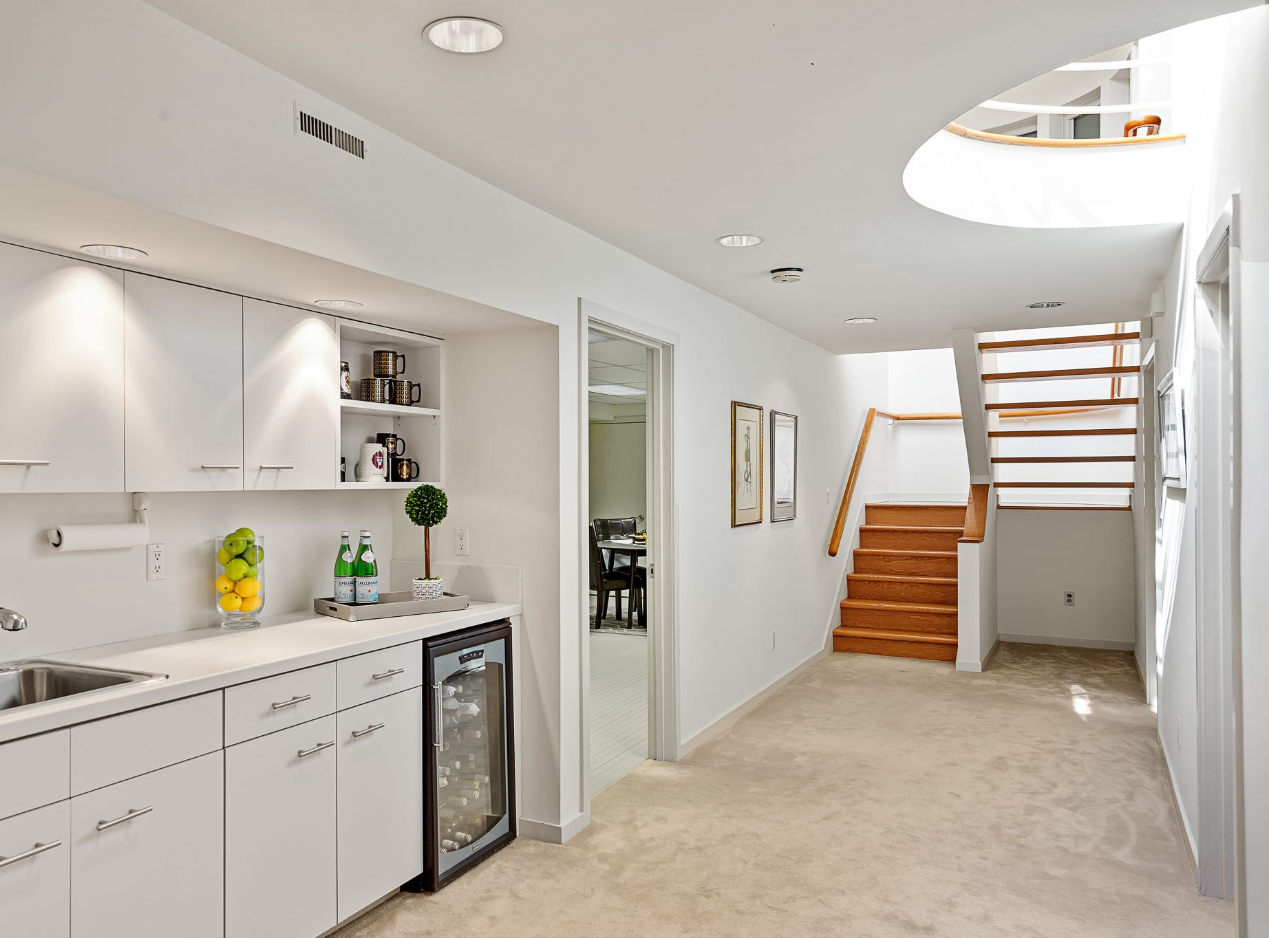 A lower-level area has a kitchenette and a wine fridge at 3611 Centreville Road in Greenville.
