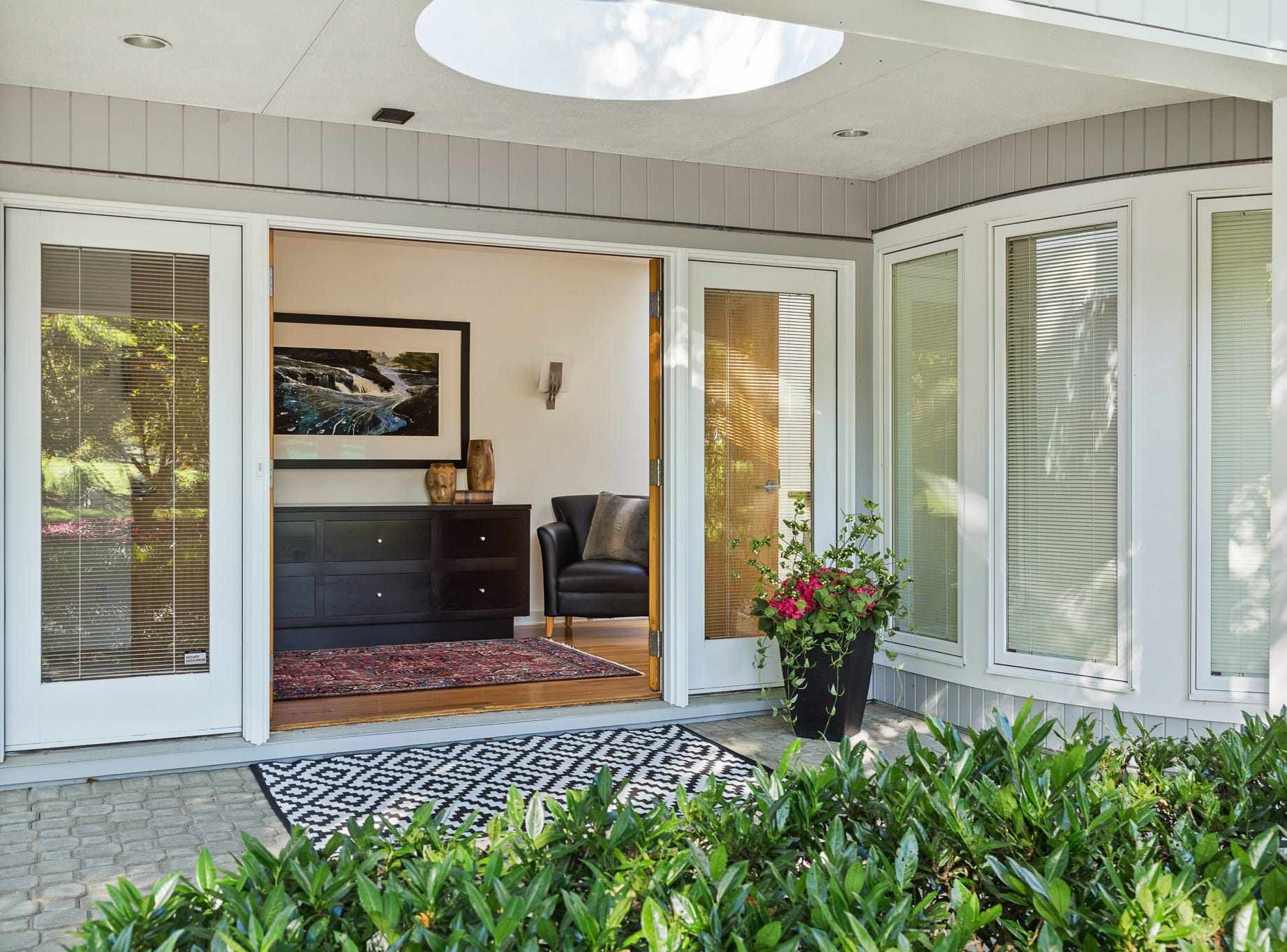A broad foyer welcomes guests to the contemporary house at 3611 Centerville Road in Greenville.