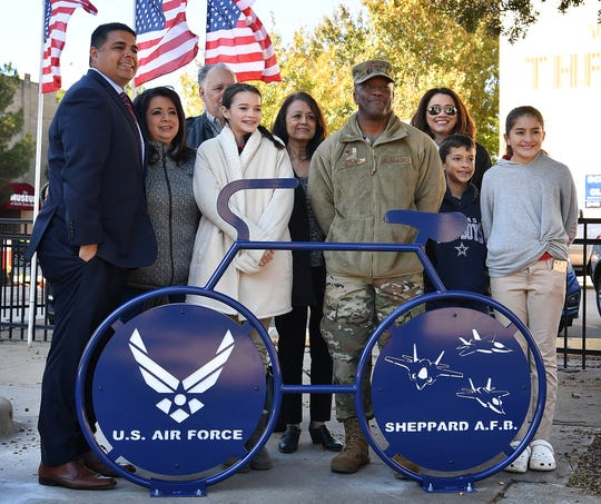 The Santellana family is photographed with Brig. Gen. Ronald Jolly Sr. at the unveiling of a special bike rack the family sponsored to honor Sheppard Air Force Base.