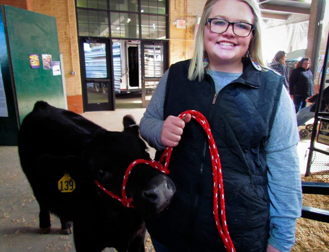 Mollie Allen of Kasson is the recipient of a 5-month-old Angus calf in a contest held by the Minnesota Beef producers. The new calf, Piper, will join Mollie and her father's growing herd at her grandfather's farm near Dodge Center.