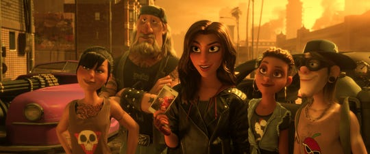"Shank (voiced by Gal Gadot, center) is the leader of a muscle-car crew in the online game ""Slaughter Race"" in the animated sequel ""Ralph Breaks the Internet."""
