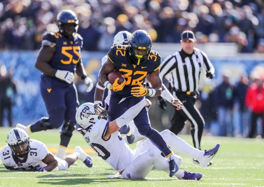 West Virginia running back Martell Pettaway runs the ball during the second quarter against TCU