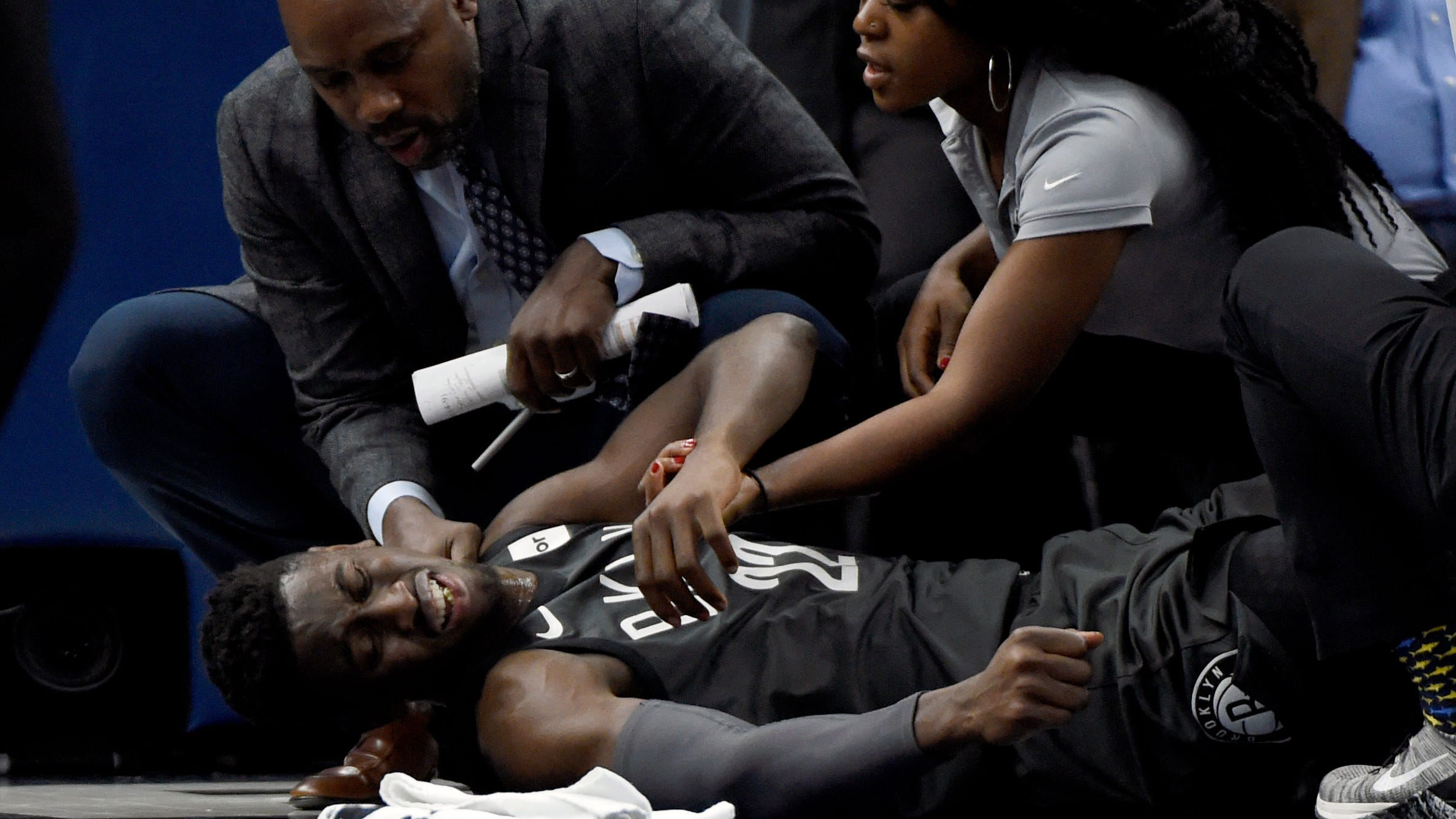Brooklyn Nets guard Caris LeVert is tended to after an injury during the second quarter of a game against the Minnesota Timberwolves.
