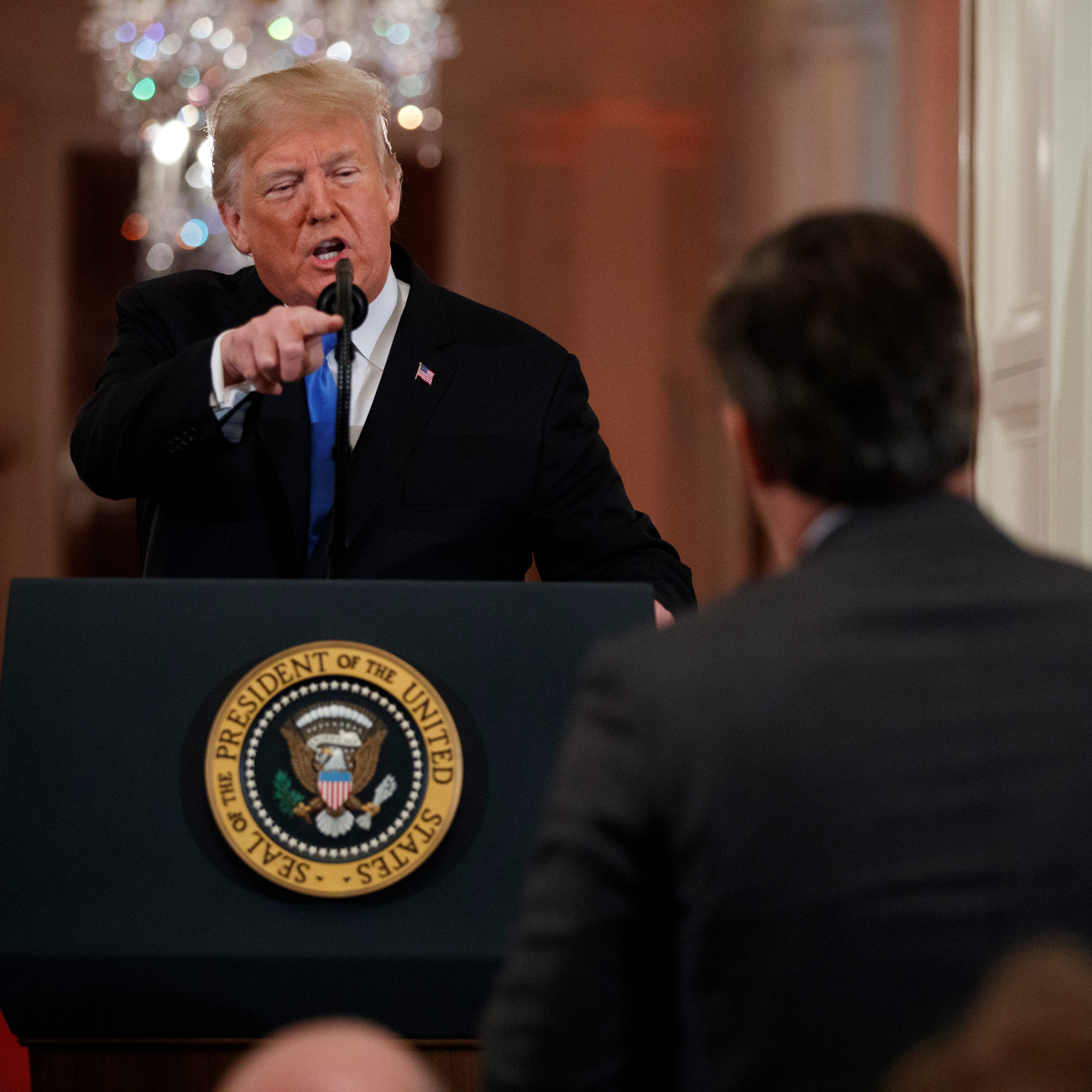 President Donald Trump speaks to CNN journalist Jim Acosta during a news conference in the East Room of the White House, Nov. 7, 2018, in Washington.