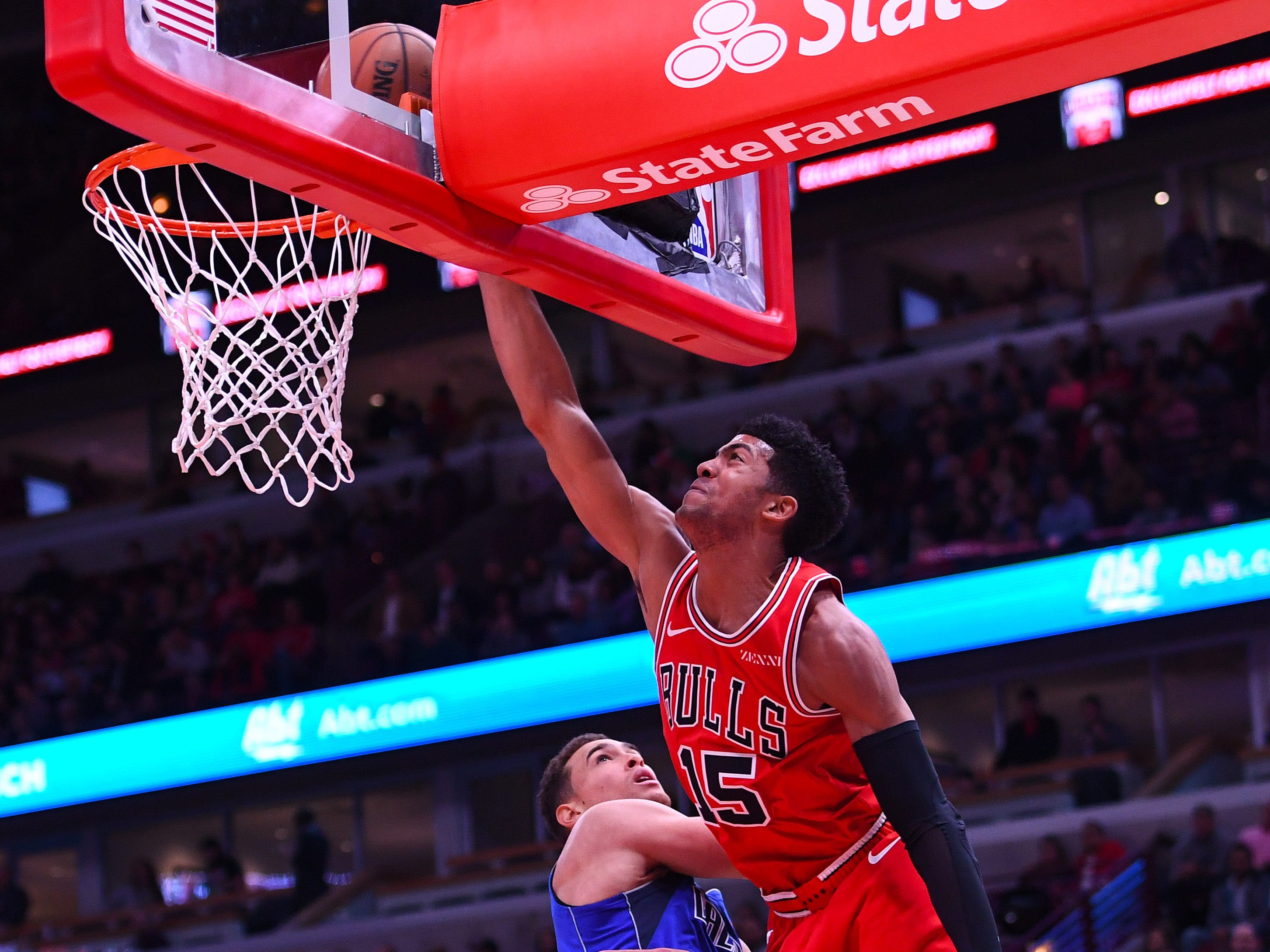 Nov. 12: Bulls forward Chandler Hutchison (15) rises up for a one-handed dunk over Mavericks forward Dwight Powell during the first half in Chicago.