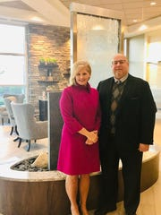 Amy Durham, 46, with Dr. Joseph Garbely, who helped save her life when her alcohol addiction left her comatose with triple organ failure in 2012. Photo taken Oct. 24, 2018 at the Carole and Ray Neag Medical Center on Caron Treatment Centers' campus in Wernersville, PA.
