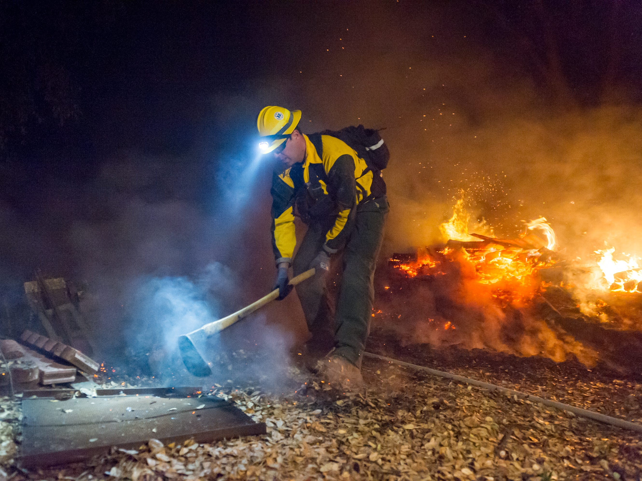 Firefighters continue to work around the clock battling the Camp Fire blaze near Butte Valley, Calf., Monday, Nov. 12, 2018.
