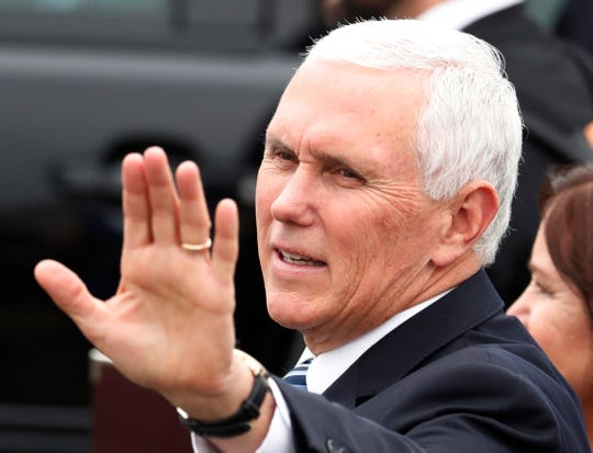 U.S. Vice President Mike Pence waves before he boards Air Force Two at the Yokota U.S. Air Force Base in Fussa, outside Tokyo, Japan, Tuesday, Nov. 13, 2018.