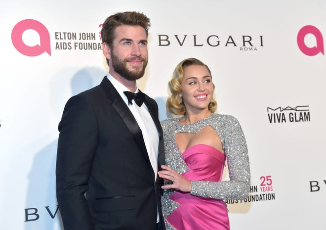 Liam Hemsworth and Miley Cyrus attend the Elton John AIDS Foundation's Academy Awards Viewing Party on March 4, 2018 in West Hollywood.
