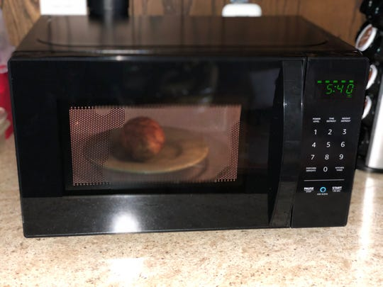 Nuking a muffin in the AmazonBasics Microwave.