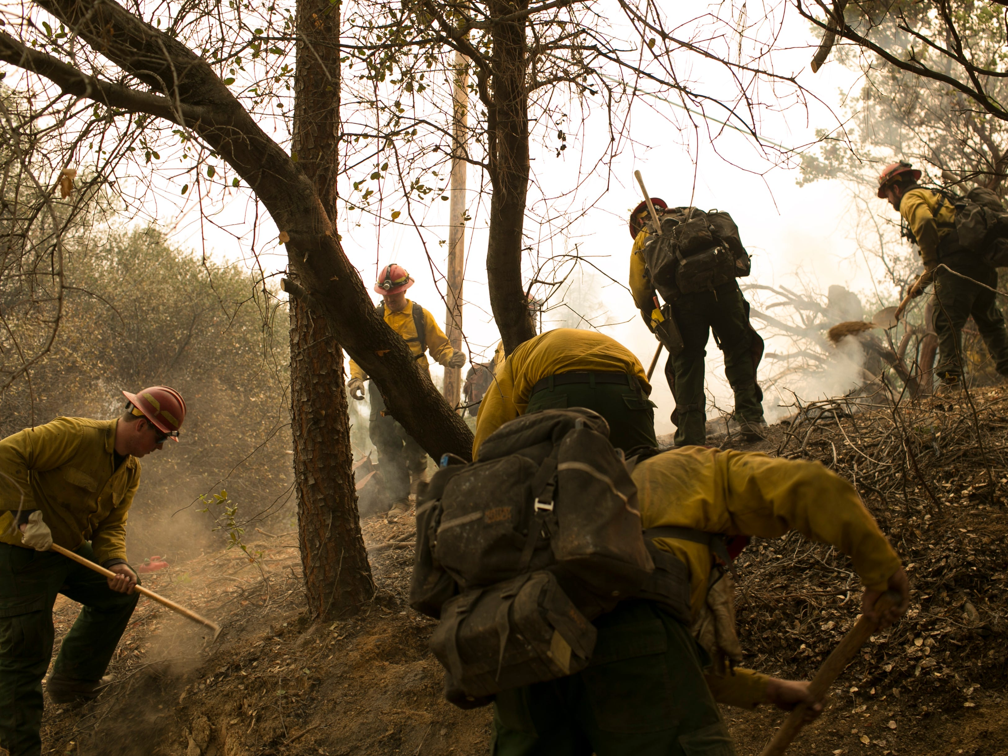 Firefighters work off of Highway 70 near the Camp Fire on Nov. 12, 2018, in Butte Valley, Calif.