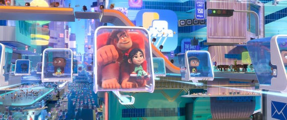 "Ralph (voiced by John C. Reilly, center left) and Vanellope (Sarah Silverman) are captivated by the World Wide Web in ""Ralph Breaks the Internet""."