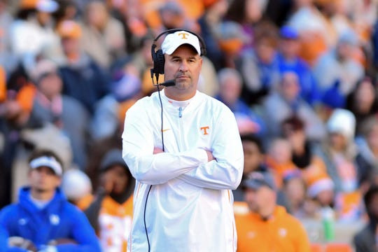 Tennessee coach Jeremy Pruitt watches his team during the first half against Kentucky.