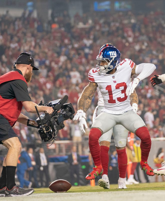 Odell Beckham celebrates after catching a touchdown pass against the 49ers.